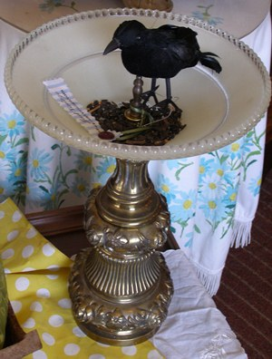 Bird feeder made from a lamp base and glass ceiling shade