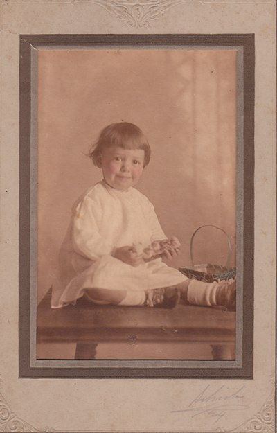 Antique photo of a little girl and her Easter basket