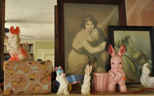 Vintage Easter bunny decorations on mantle.