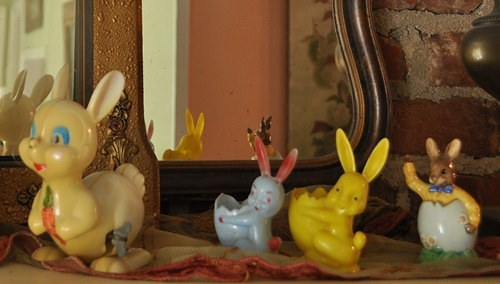 Vintage Easter bunny decorations on the mantle.