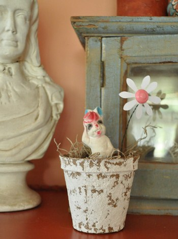 Vintage, chalk bunny in a painted peat pot