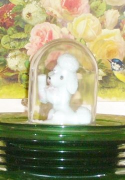 Poodle figurine under a cloche