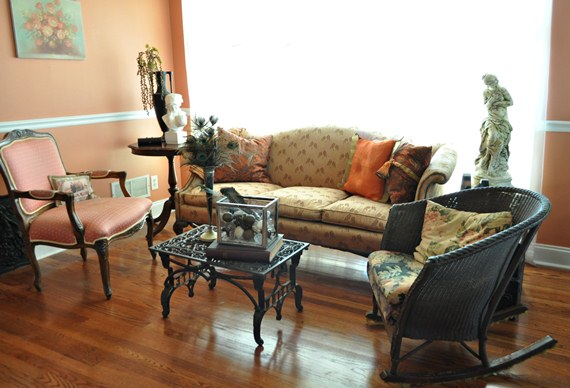 Living room with sewing machine base and metal door mat coffee table: Just Vintage Home