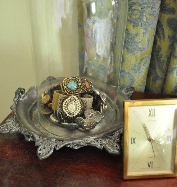 Cuff bracelets under a cloche