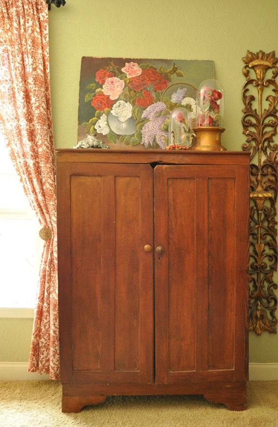 Primitive cupboard, florals and red print drapes