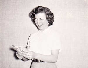 "My mother with the money she won in a radio contest for being the first caller to identify the song, ""Tico Tico"" in the 1950s."