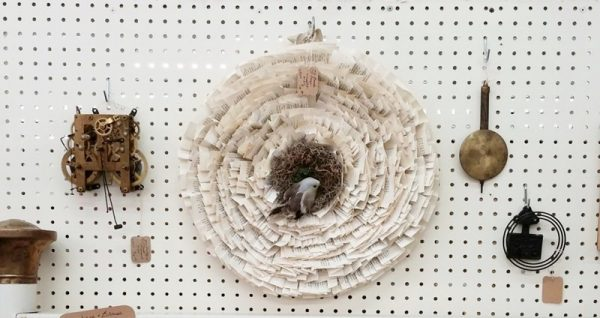 Book page wreath and clock parts as wall decor