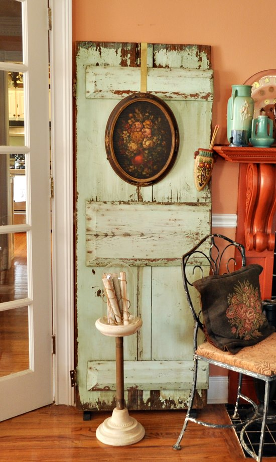 Old turquoise door used in living room decor