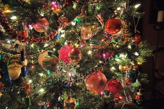 Close up of vintage ornaments on a traditional Christmas tree