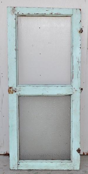 Antique door with half glass.