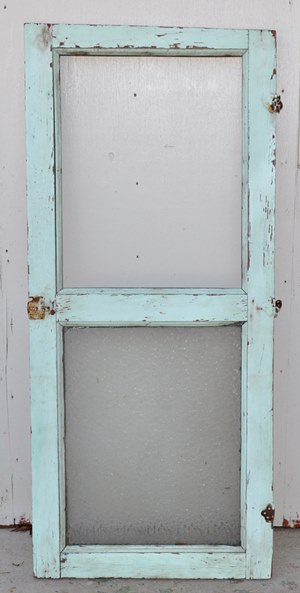 Antique door with half glass.
