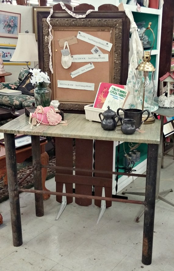 Industrial metal table with marble top