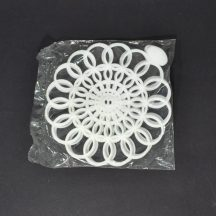 """Unopened pack of white, 6"""", vintage Tupperware doilies"""