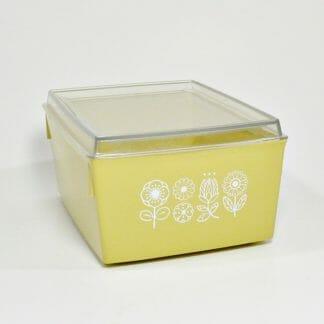 Vintage kitchen storage box in harvest gold with raised white flowers