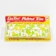 Vintage shelf edging. Pleated plastic in yellow and green on white background. Still in original packaging.