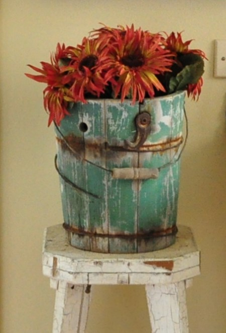 Fall decorating with flowers in green ice cream bucket