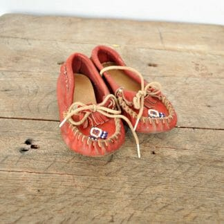 Child's vintage moccasins. Red with blue and white beading. Perfect for Native American or Western decor.