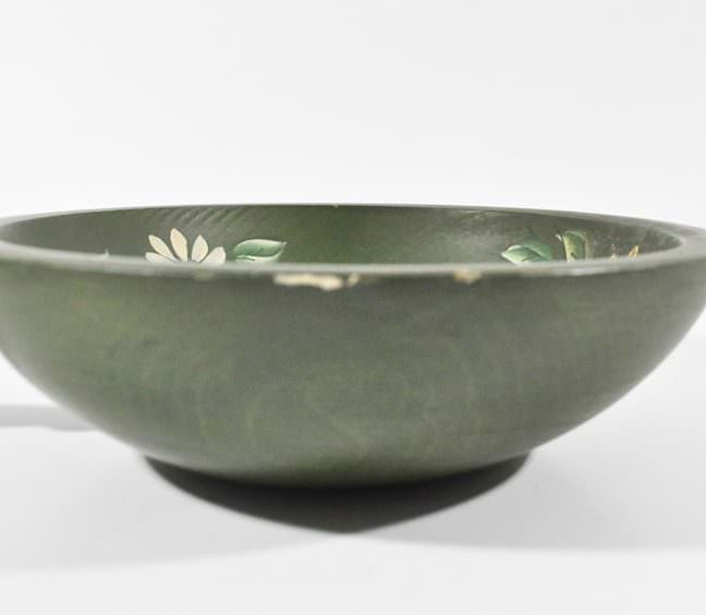 Side of vintage nut bowl painted green with hand painted daisies