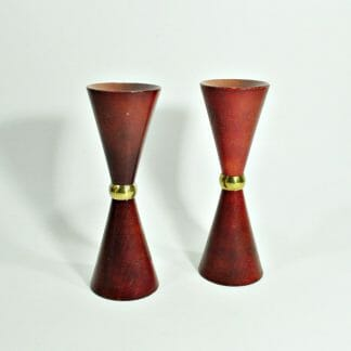 """6"""" mcm teak candle holders with brass centers. Hourglass shape."""