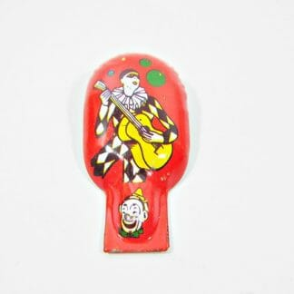 Vintage tin clicker with Harlequin lithograph, made by US Metal Toy Mfg