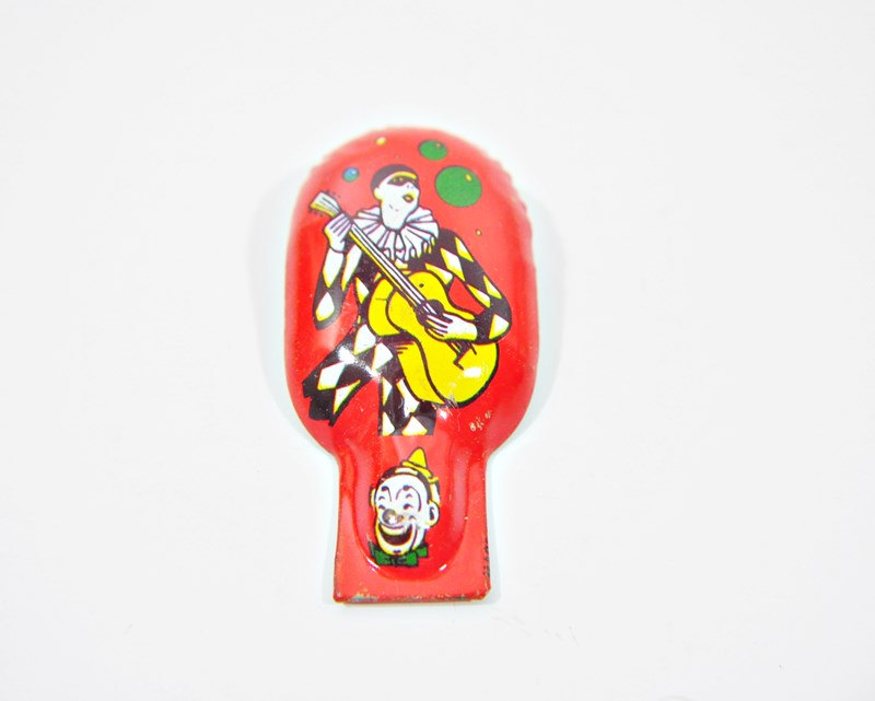 Vintage Tin Clicker Harlequin Musician Graphic Made By US Metal Toy Mfg.