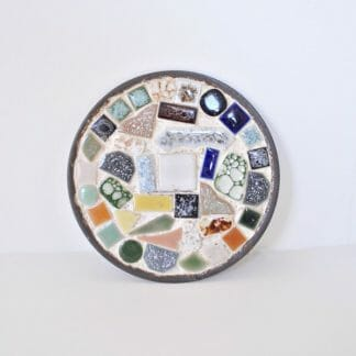 "5-1/4"" round, mosaic tile trivet set in a tin base."