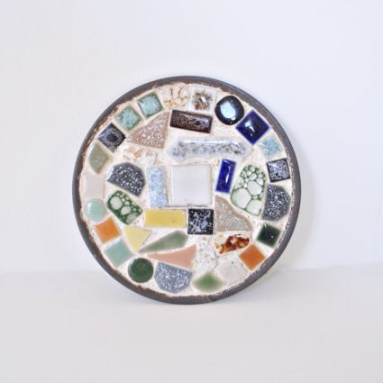 "5-1/4"" round, mosaic tile trivet set in a tin base."