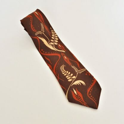 Vintage Beau Brummell tie. Brown silk with orange and cream color ferns. From Marble City Drygoods in Sylacauga, Alabama