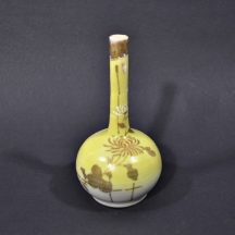 "Small, vintage sake bottle. Yellow with gold, painted chrysanthemums and trim. 4-3/4"" tall."