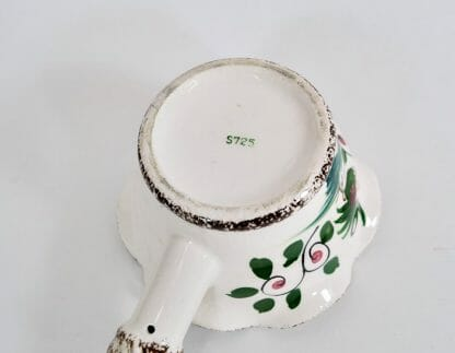 Bottom of rooster and flowers gravy boat