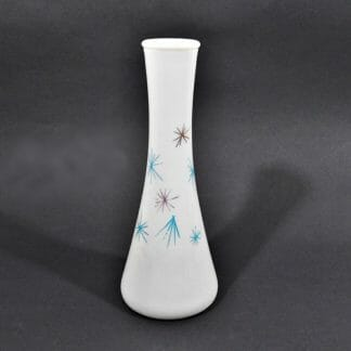 Mid century starburst milk glass vase. Aqua and gold starbursts. Available at Just Vintage Home.