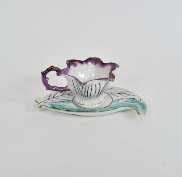 Tiny leaf and flower shaped cup and saucer made in Japan