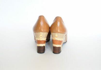Backs of vintage 1980's patchwork wedge heel shoes in size 6 by Mr. Seymour.