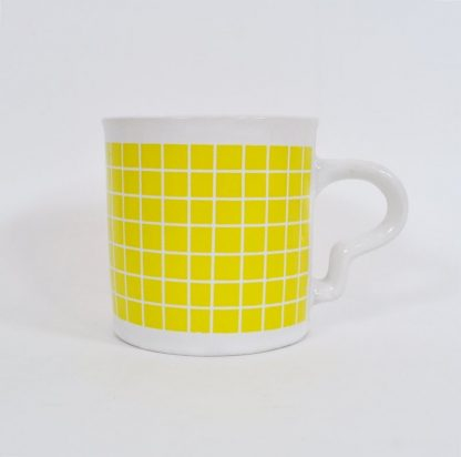 Close-up of yellow check mug