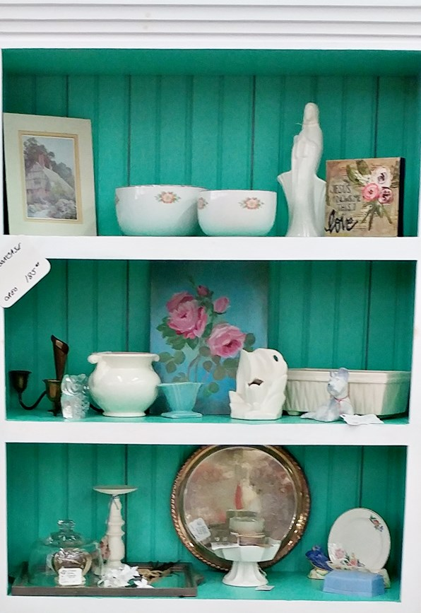 Bookcase staging in an antique booth