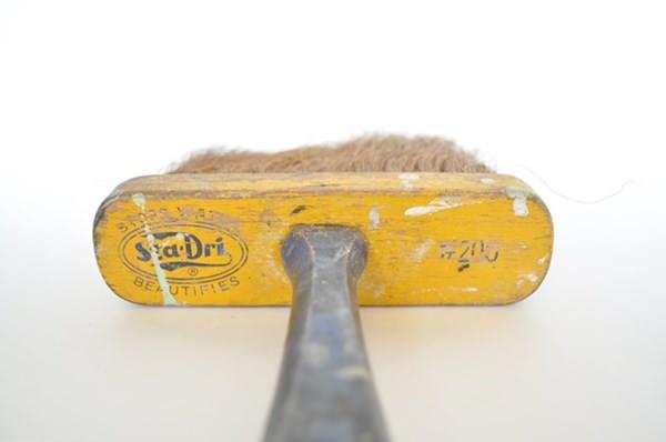 Large vintage yellow paint brush