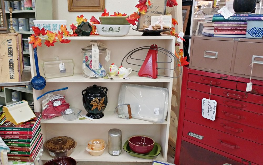 Bookcase with kitchen items in the booth