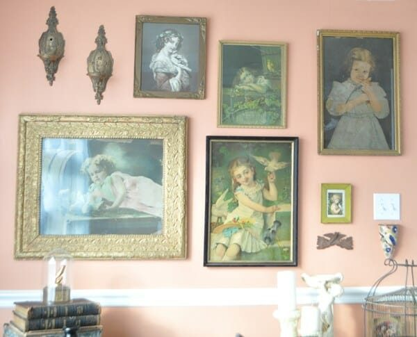 Gallery wall of little girls with birds prints