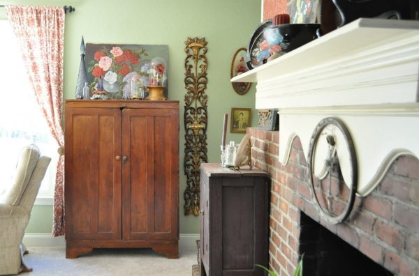 Primitive cabinet with a mix of mid century, florals, and golds