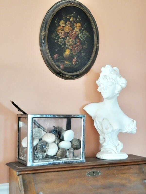 Collection of antique doorknobs in a small aquarium