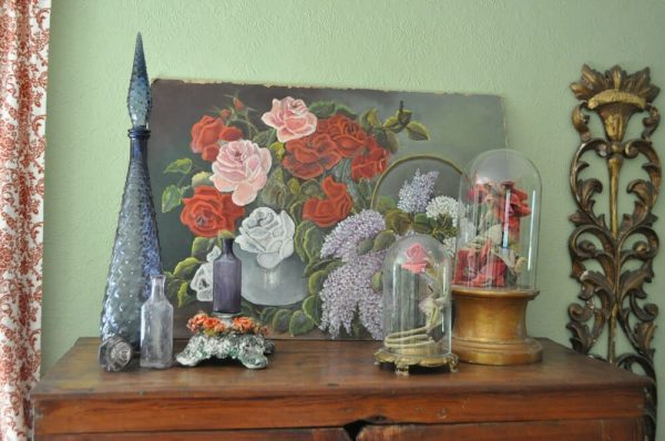 Vignette of mixed styles of mcm, feminine, Victorian, and florals