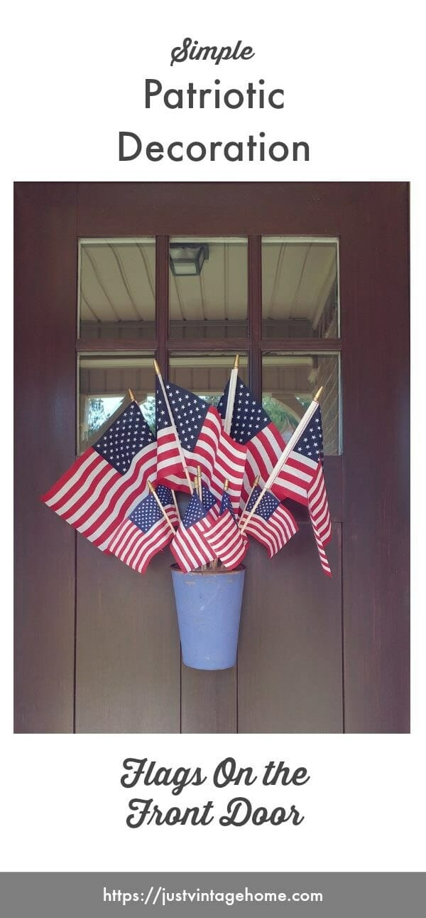 Patriotic decoration for the front door using flags and a blue, hanging bucket!