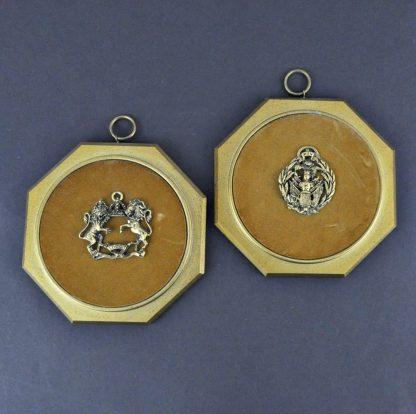 Vintage coat of arms plaques