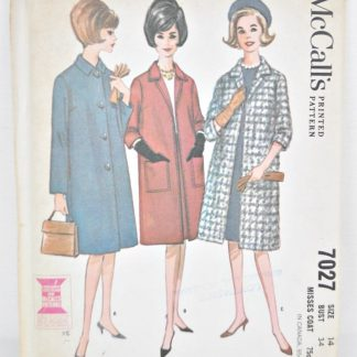 """Vintage coat pattern from the 1960s. McCall's 7027, size 14, bust 34"""". Unused sewing pattern. Knee length with sleeve options of long or 3/4 length."""