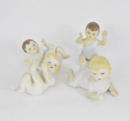 Set of 4 small piano babies