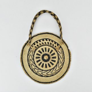Boho straw purse used as wall hanging