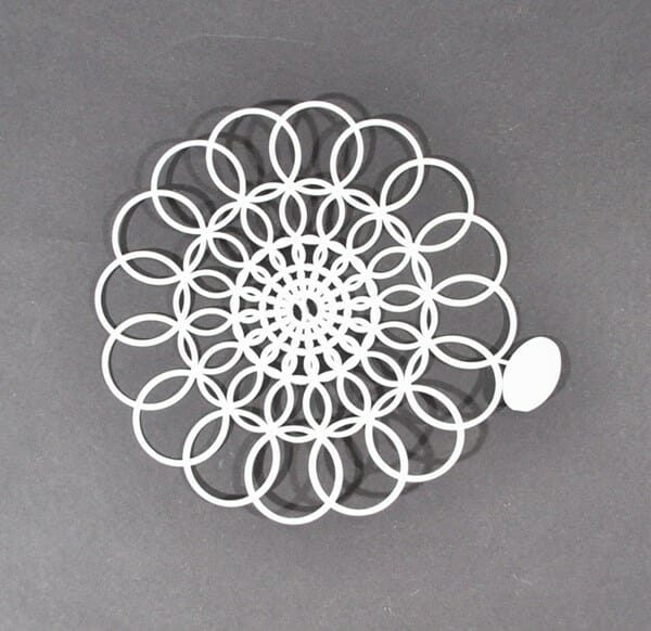 "6"" Tupperware doily with tab attached"