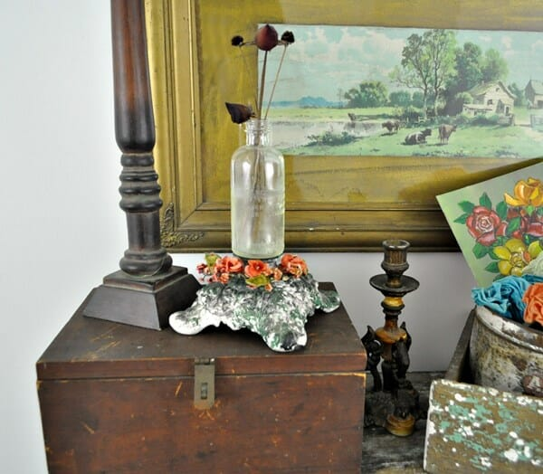 Vignette using an old box, candlesticks and florals