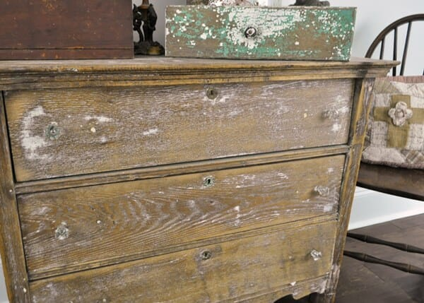 Oak chest with old, mint green paint showing in the grain