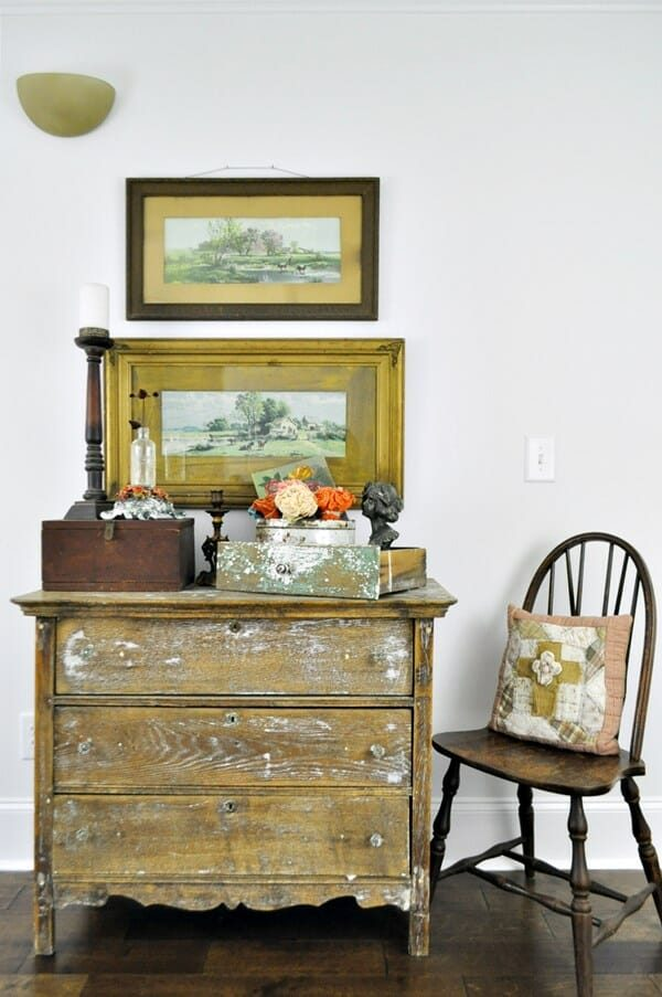 Hall vignette using old, oak chest, antique landscape prints, chippy drawer and other odds and ends. Things that wouldn't necessarily go together, but seem to work.